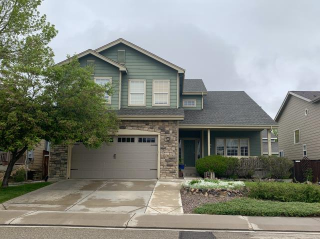 Longmont, CO - We re-roofed two homes for the customer that owns this home in Longmont.  This is the first one, on which we installed GAF Timberline HD shingles in the color Weathered Wood.
