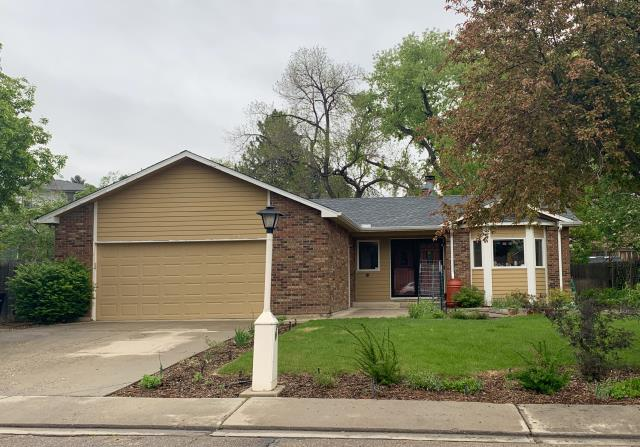 Longmont, CO - This home in Longmont was hit with hail last summer, but now it has a gorgeous new roof.  The shingles we installed are GAF Timberline HD shingles in the color Pewter Gray.