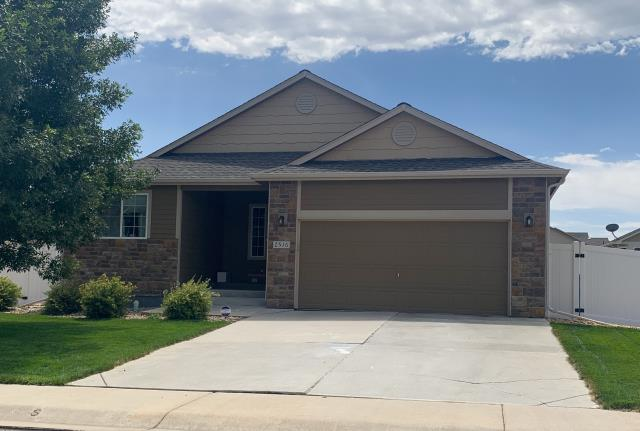 Mead, CO - This home in Mead has a new roof installed by us on it.  We installed GAF Timberline HD singles in the color Weathered Wood.