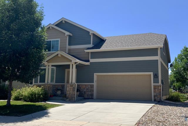 Fort Collins, CO - This is a home in Fort Collins that was hit with hail last summer and was in need of a new roof.  We installed CertainTeed Northgate Class IV Impact Resistant shingles in the color Weathered Wood.
