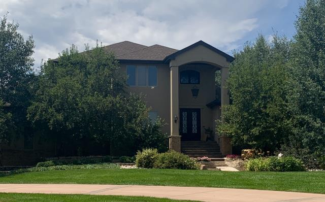Mead, CO - We installed a new roof on this home in Mead.  The shingles that we installed are GAF Timberline HD shingles in the color Barkwood.