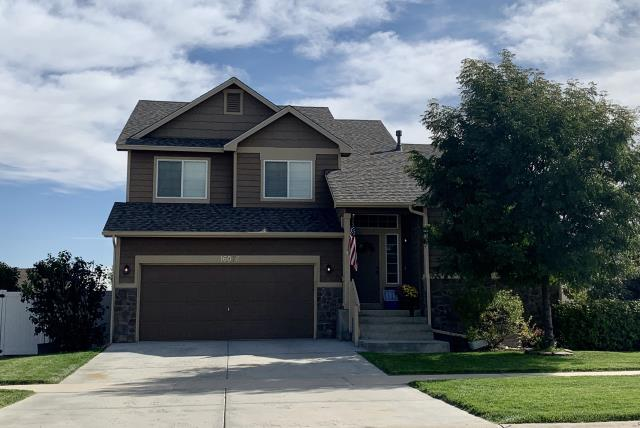 Mead, CO - We installed a new roof on this home in Mead.  The shingles we installed are CertainTeed Northgate Class IV Impact Resistant shingles in the color Weathered Wood.