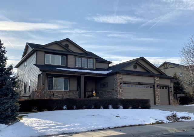 Longmont, CO - The new roof on this home in Longmont or the southern part of Mead, is a CertainTeed Landmark IR roof.  The shingles are Class IV impact resistant shingles.  The color is Weathered Wood.