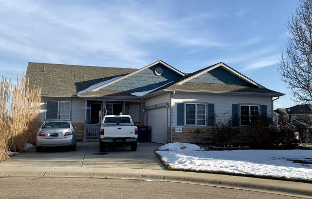Longmont, CO - Still a lot of snow out there - can you believe this snow is from the storm before Thanksgiving!  On this home in Firestone, we installed GAF Timberline HD shingles in the color Weathered Wood.