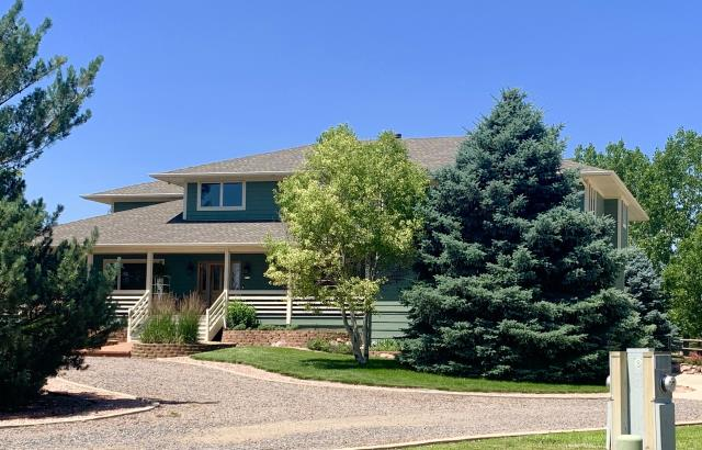 Mead, CO - We installed a new roof on this home in Mead as well as on a barn and a detached garage on the property.  The color of the shingles is Weathered Wood.