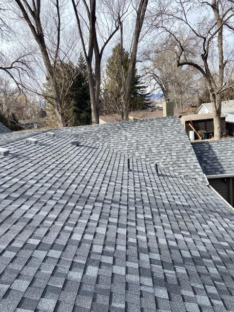 Niwot, CO - View from the rooftop of a roof we recently finished.  When you are driving around look and see - did the roofer paint all the vents and pipes?  You can tell if a roofer pays attention to detail by looking at that.  You will see, especially on track homes, that often roofers don't do that and it does not look as nice.  The shingles that we installed on this roof in Niwot are CertainTeed Northgate Class IV Impact Resistant Shingles in the color Pewter.