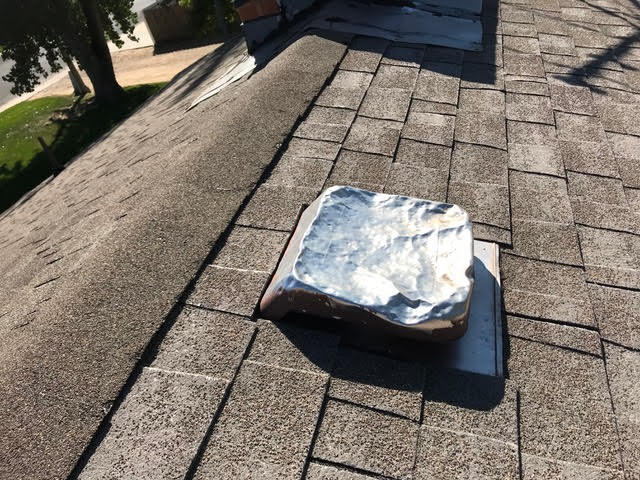 Niwot, CO - One way to know if you have hail damage, is to look at your vents.  This one in Niwot is definitely hail damaged.  You can also see a lot of granule loss on the shingles in this photo.  We replaced this roof with a new CertainTeed Northgate Class IV Impact Resistant roof.