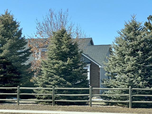 Mead, CO - It's hard to see from the street, but this home in Mead on County Road 7 has a nice new roof on it.  If you are running along County Road 7 just north of Highway 66 take a peak as you go by.  The shingles we installed are CertainTeed Landmark shingles in the color Moire Black.