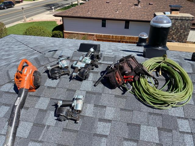 Longmont, CO - Tools of the roofing trade...  on a roof in Longmont.  The shingles are CertainTeed Northgate Class IV Impact Resistant Shingles in the color Max Def Pewter.