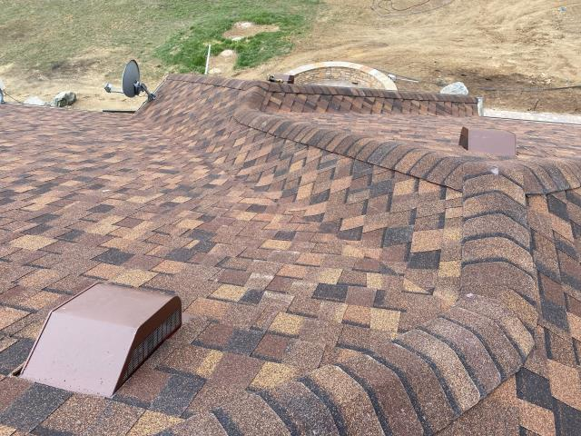 Longmont, CO - View from the roof - this roof in Longmont is just being finished up.  I really appreciate our crew and their willingness to do what they do.  It looks like a long way down!  The shingles here are CertainTeed Northgate Class IV Impact Resistant Hail Shingles, in the color Burnt Sienna.