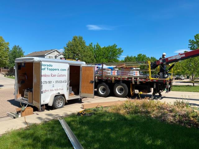 Fort Lupton, CO - We are working just down the street from our shop today in Mead.  Gutters are being installed and the roof is being loaded.  The shingles we will install are CertainTeed Northgate Class IV Impact Resistant Shingles in the color Granite Gray.