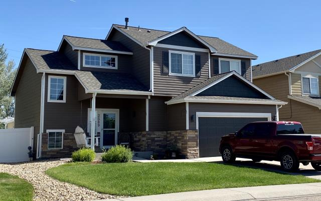 Mead, CO - After we installed the new roof on this home in Mead, the homeowners also had the house painted.  What a transformation!  The shingles we installed are GAF Timberline HD shingles in the color Weathered Wood.