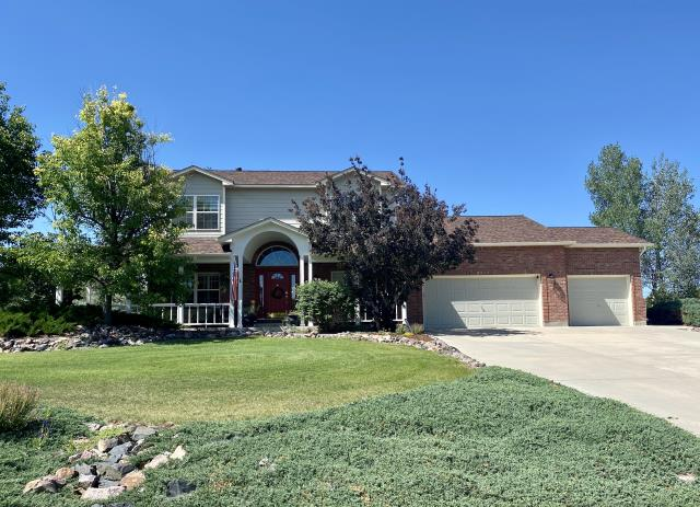 Longmont, CO - This home in Longmont had a hail damaged roof.  We installed a new CertainTeed Northgate Class IV Impact Resistant roof on this home in the color Heather Blend.