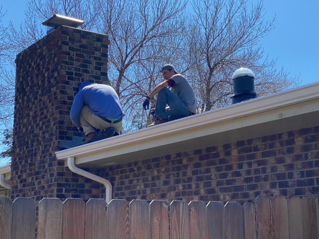Longmont, CO - Here is our crew busy at work flashing a chimney in Longmont.  We installed Certainteed Northgate Class IV shingles on this roof in the color Max Def Pewter.