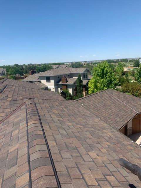 Fort Collins, CO - Rooftop view of the finished roof that I posted yesterday in Fort Collins.  These shingles are designer shingles - they are thicker and have a custom shape.  They are CertainTeed Belmont Class IV Impact Resistant shingles in the color Shenandoah.