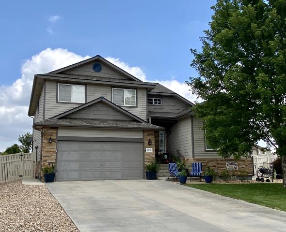 Longmont, CO - We installed a new CertainTeed Landmark asphalt shingle roof on this home in Firestone that was hit with hail damage.  The shingle color is Weathered Wood.