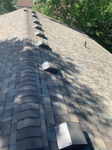 Longmont, CO - It is hot today!  How well is your attic ventilated?  When you install a new roof, that is the time to improve your attic ventilation.  There are two ways to do it.  Either have ridge vent installed or add more slant back vents, which is what this customer in Longmont chose to have us do.  The shingles you see here are CertainTeed Northgate Class IV Impact Resistant Shingles in the color Weathered Wood.