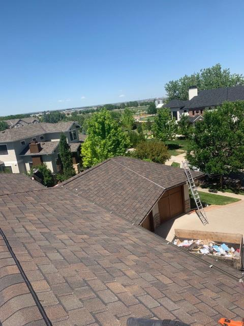 Fort Collins, CO - One way to increase the value of your home and really upgrade your curb appeal is through the use of designer shingles, like the ones on this roof we installed in Fort Collins.  Designer shingles are thicker and come in different shapes to compliment the style of your home.  The designer shingles shown in this picture are CertainTeed Belmont Class IV Impact Resistant shingles.  They are not only designer shingles with a unique shape, but they are also impact resistant.