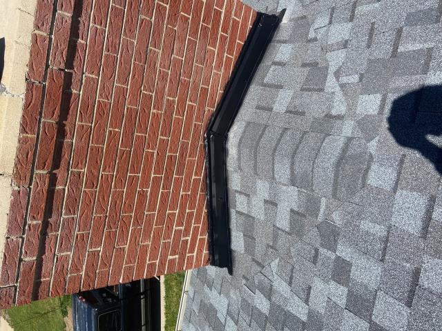 Longmont, CO - A well done cricket is a thing of beauty.  A cricket on a roof is an area behind a chimney designed to prevent snow from piling up behind a chimney.  You can see one is this picture on a roof in Longmont that we installed.  The shingles you see here are CertainTeed Northgate Class IV Impact Resistant shingles in the color Max Def Pewter.