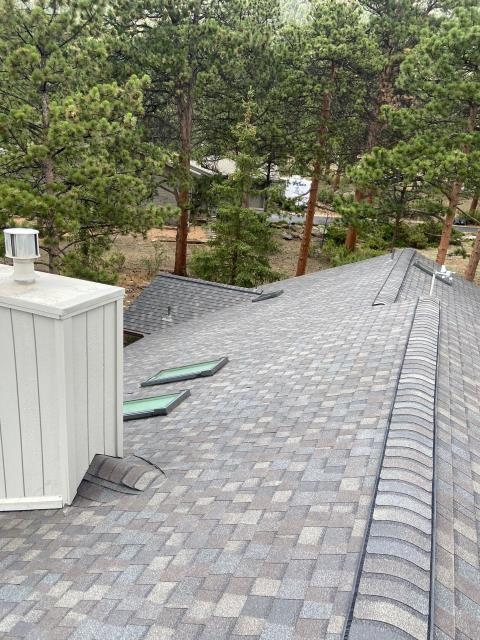 Estes Park, CO - The right time to replace your skylights is when you are having a new roof installed.  Having the skylights replaced when a new roof is installed, allows us to make sure that they are flashed correctly and will not cause any leaks.  The shingles on this roof in Estes Park, are CertainTeed Landmark shingles in the color Driftwood.