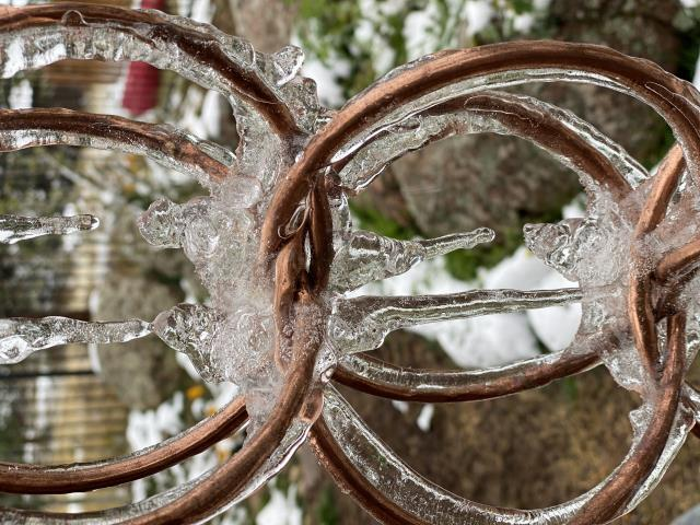Mead, CO - Today we got to see how our new rain chain looks when snow is melting off the roof and the water turns to ice.  What a work of art!