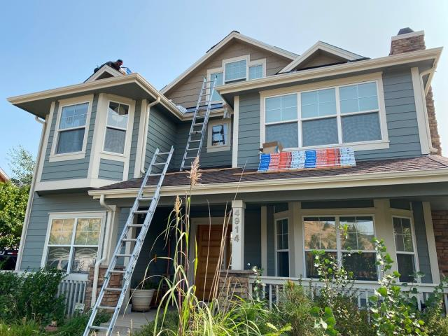 Boulder, CO - Our crew is busy finishing up this roof in Boulder this morning.  The shingle they are installing are CertainTeed Northgate Class IV Impact Resistant shingles in the color Moire Black.