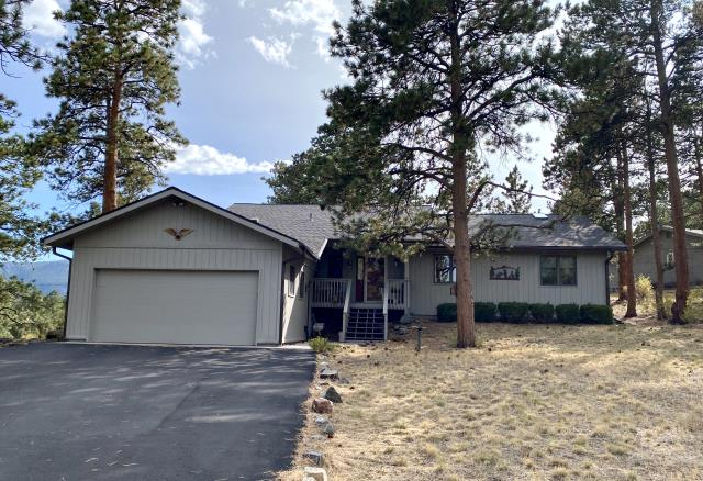 Estes Park, CO - This home in Estes Park is ready for winter with a new CertainTeed Landmark roof in the color Driftwood.