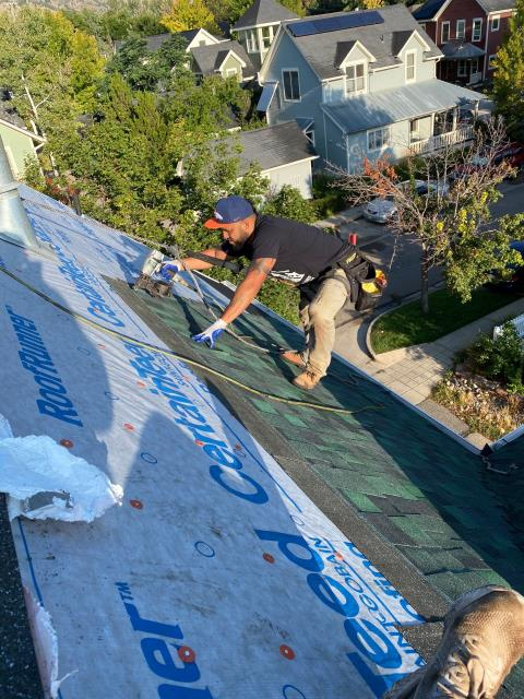 Boulder, CO - Here you see our crew working on a steep roof in Boulder installing CertainTeed Northgate Class IV Impact Resistant shingles in the color Hunter Green.