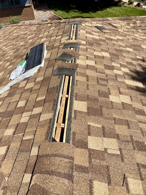 Longmont, CO - This roof in Longmont is having ridge vent installed.  This picture is a great example of how the crew preps the ridge line to install the ridge vent.  The shingles you see here are CertainTeed Northgate Class IV Impact Resistant Shingles in the color Resawn Shake.