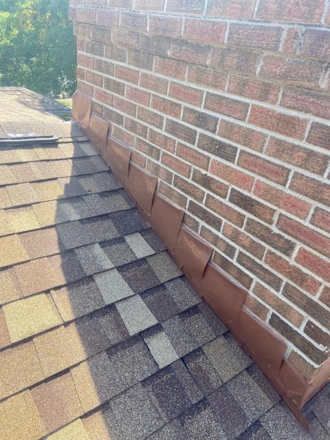 Longmont, CO - Another chimney flashing done right - the key to a chimney not leaking.  The shingles you see here that we installed on this roof in Longmont are CertainTeed Northgate Class IV Impact Resistant shingles in the color Resawn Shake.
