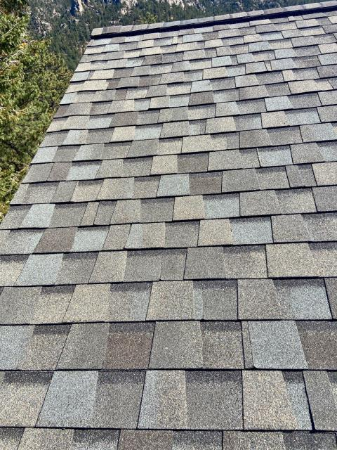 Estes Park, CO - Love this roof view in Estes Park.  Looks like if you go over the other side it is a loooong way down - and it could be.  The shingles we installed on this roof are CertainTeed Northgate Class IV Impact Resistant shingles in the color Weathered Wood.