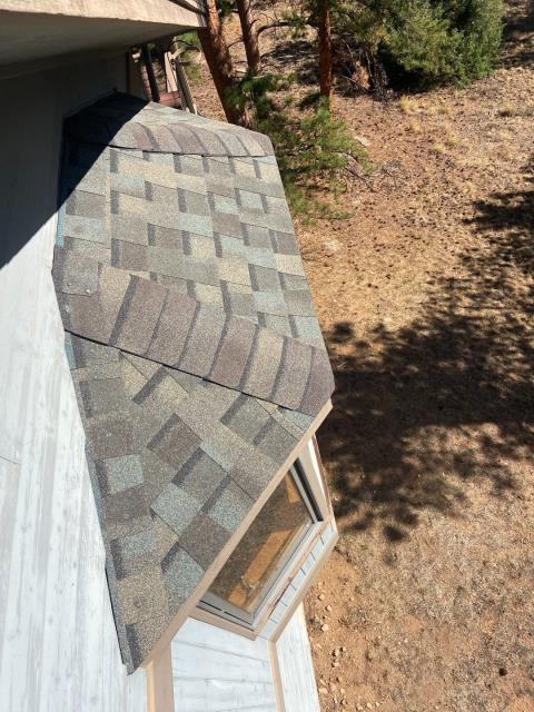 Estes Park, CO - We call this an eyebrow - it's a little section of roof over in this case, a bay window.  This roof in Estes Park, is a CertainTeed Northgate Class IV Impact Resistant roof.  The shingle color is Weathered Wood.