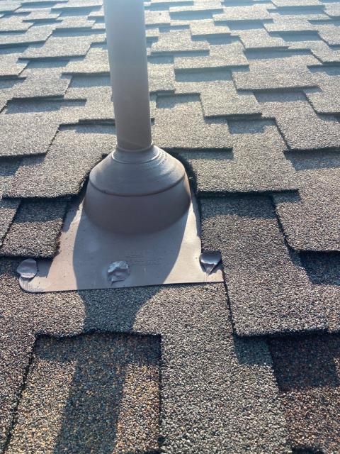 Longmont, CO - A properly flashed pipe flashing or pipe jack as they are sometimes called, on a roof in Longmont.  This roof is a CertainTeed Presidential Shake shingle roof - a heavy designer shingle with great a dimensional look.