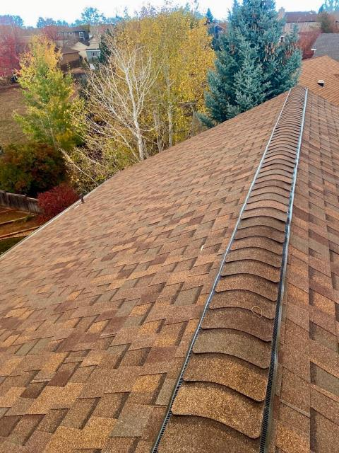 Fort Collins, CO - Nice ridge line view from this roof in Fort Collins that we installed.  The shingles you see here are CertainTeed Northgate Class IV Impact Resistant Shingle in the color Heather Blend.