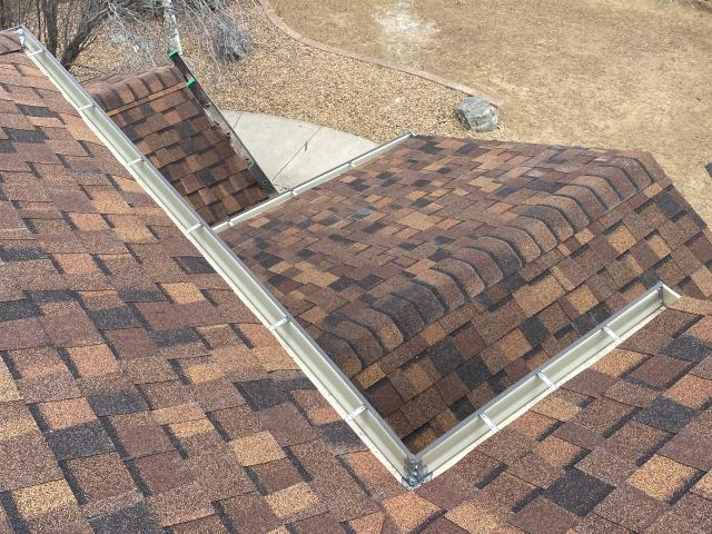 Longmont, CO - This new roof and gutters in Longmont are getting a good test today - it's snowing!  The shingles you see here that we installed are CertainTeed Northgate Class IV Impact Resistant shingles in the color Burnt Sienna.