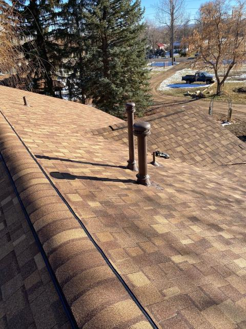 Longmont, CO - The snow is just about gone in Longmont now - some still in the yard of the home where we installed this roof.  The shingles that were installed on this roof are CertainTeed Landmark shingles in the color Heather Blend.