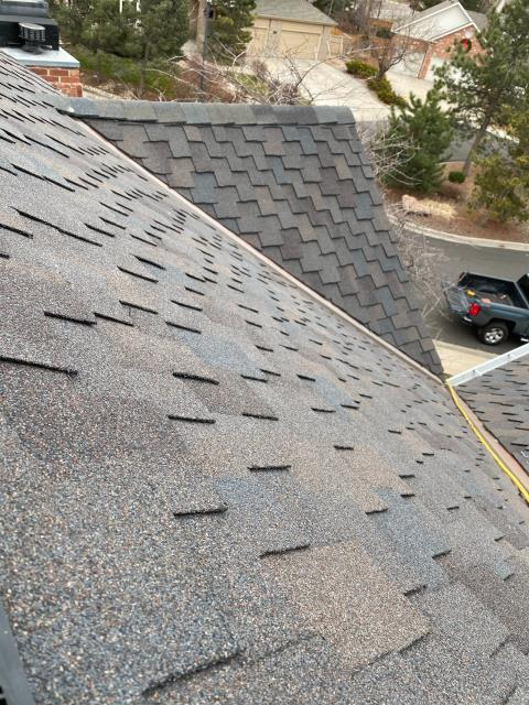 Fort Collins, CO - In this picture the crew is finishing up a CertainTeed Presidential Shake Impact Resistant roof in Fort Collins.  The shingle color is Shadow Gray.  Presidential shingles are a designer shingle that are thicker and have an even more dimensional look than standard shingles.