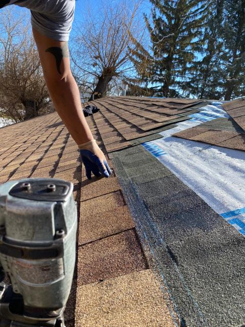 Boulder, CO - Our crew is installing CertainTeed Northgate Class IV Impact Resistant shingles in the color Resawn Shake on a roof in Boulder in this photo.