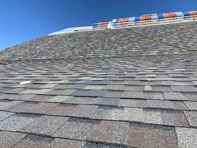 Longmont, CO - One side almost done, as the crew works their way to the top on this roof in Longmont.  We are installing CertainTeed Northgate Class IV Impact Resistant shingles.  The color is Driftwood.