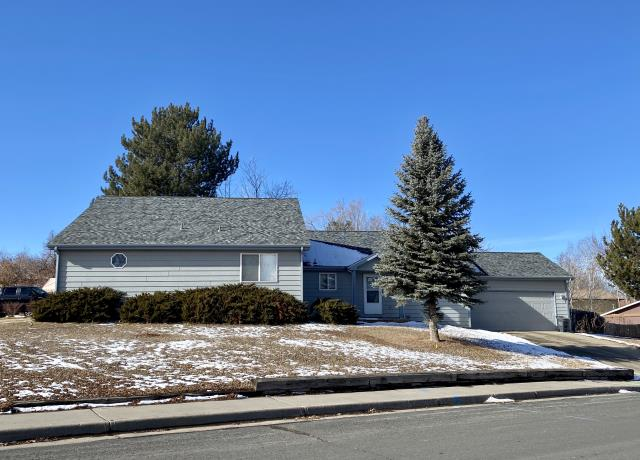 Loveland, CO - This duplex in the southern part of Loveland has a new CertainTeed Northgate Class IV Impact Resistant roof installed on it.  The shingle color is  Granite Gray.