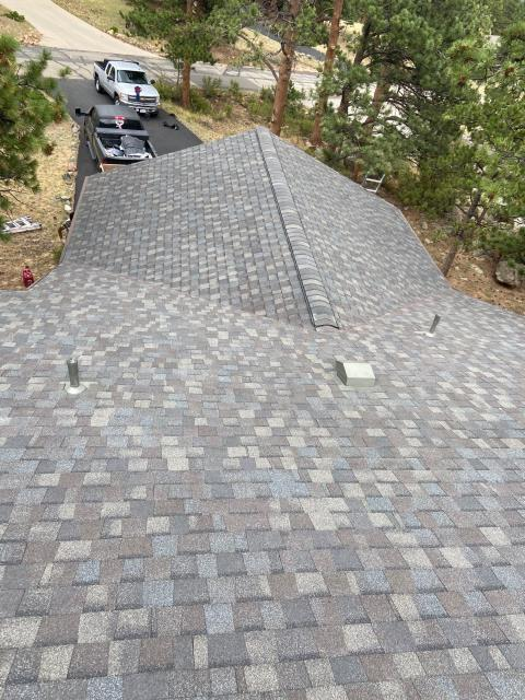 Estes Park, CO - In this picture the crew was finishing up a new CertainTeed Landmark roof in Estes Park.  The shingle color is Driftwood.