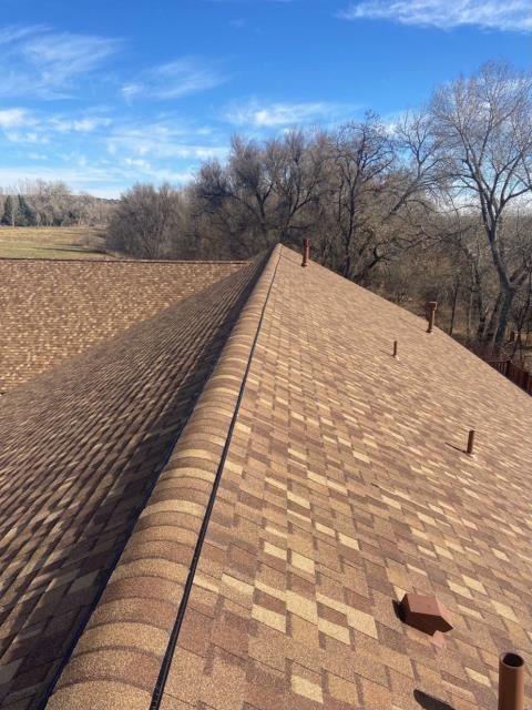 Boulder, CO - It's a gorgeous sunny day on this roof in Boulder.  Don't let the weather fool you - snow is coming!  The shingles you see here are CertainTeed Northgate Class IV Impact Resistant shingles in the color Resawn Shake.