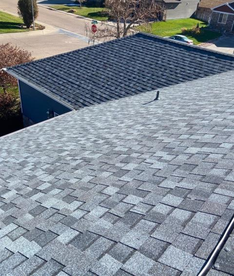 Eaton, CO - I'm guessing this roof in Eaton has a layer of white on it this morning hiding the beautiful CertainTeed Northgate Class IV Impact Resistant shingles that we installed.  The shingle color is Pewter.