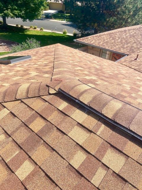 Longmont, CO - Nice view of a roof in Longmont that we replaced a skylight on and installed ridge vent on while we were roofing.  The shingles that we installed are CertainTeed Northgate Class IV Impact Resistant shingles in the color Resawn Shake.