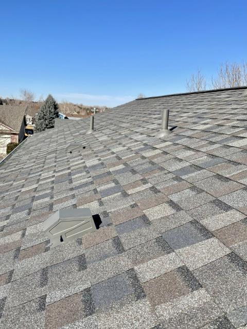 Fort Collins, CO - What a difference a day makes!  This was a brown roof and now it is gray.  Yesterday when we installed this it was a beautiful sunny day.  Today, well... The shingles that we installed on this roof in Fort Collins are CertainTeed Northgate Class IV Impact Resistant shingles in the color Driftwood.