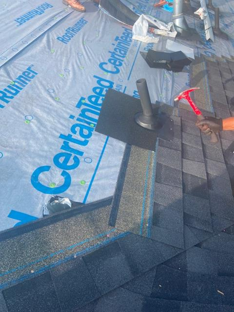 Mead, CO - This photo shows how we work around pipes that are penetrating the roof.  A piece of water and ice barrier is installed, which is a water vapor barrier, to ensure that there are no leaks around the pipe. This roof in Mead is well protected!