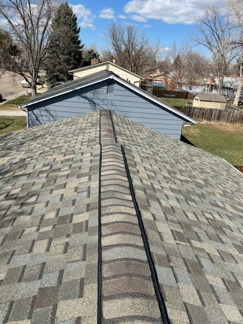 Longmont, CO - Look at the ridge vent and ridge line on this CertainTeed Northgate Class IV Impact Resistant roof in Longmont!  The shingle color is Weathered Wood.