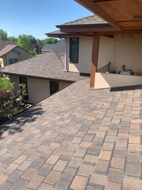 Fort Collins, CO - This roof in Fort Collins is a roof we installed using CertainTeed Belmont Class IV Impact Resistant shingles in the color Shenandoah.  These shingles are not only hail resistant, but also considered a designer shingle.  They have a different shape than standard shingles, creating a unique look that really stands out.
