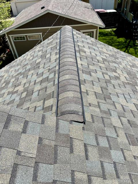 Longmont, CO - Weathered Wood, as seen here on this CertainTeed Northgate Class IV Impact Resistant roof in Longmont, is the most popular shingle color on the market.