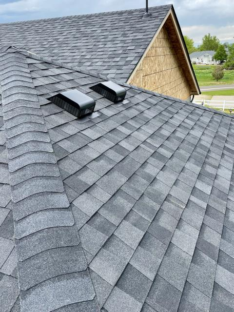 Mead, CO - This home in Mead got a new roof, and a room addition.  We didn't do the room addition, but we did the roof, coordinating everything so that the room addition would get roofed at the same time.  The shingles we installed are CertainTeed Northgate Class IV Impact Resistant shingles in the color Moire Black.